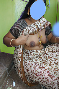 Hot Indian Village Bhabhi Showing Her Boobs